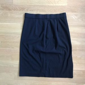 Black pleated pencil skirt by Skirtology